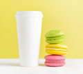 Drink macaron and tumbler of coffee Royalty Free Stock Photos