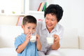 Drink milk together drinking happy multi generations asian family drinking at home beautiful grandmother and grandson healthcare Royalty Free Stock Images