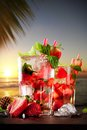 Drink mojito drinks on wood with evening blur ocean shore background Royalty Free Stock Images
