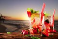 Drink mojito drinks on wood with evening blur ocean shore background Royalty Free Stock Photo