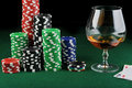 Drink and playing cards Stock Images