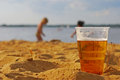 Drink responsibly think of your loved ones beer in foreground with children playing in background Royalty Free Stock Photos