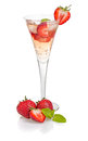 Drink with strawberries and mint in a champagne flute Stock Photography