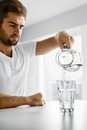 Drink Water. Close Up Man Pouring Water Into Glass. Hydration Royalty Free Stock Photo