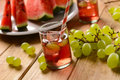 A drink of watermelon and grapes with ice cubes Royalty Free Stock Photo