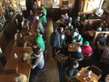 Drinkers and diners at an oregon bar on saint patrick s day corvallis or march patrons as viewed from a balcony Royalty Free Stock Photo