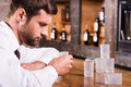 Drinking again depressed drunk man in shirt and tie leaning at the bar counter and sleeping while empty glasses standing near him Royalty Free Stock Photo