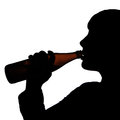 Drinking beer silhouette of a person a bottle of Stock Images