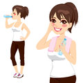 Drinking bottle water beautiful brunette holding a of and after sport exercise Stock Photo