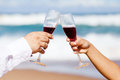 Drinking champagne on beach Royalty Free Stock Photo