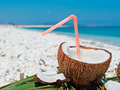 Drinking coconut plastic straw in a by the shore Royalty Free Stock Images