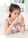 Drinking milk happy asian kid drink at home beautiful child healthcare concept Royalty Free Stock Photo