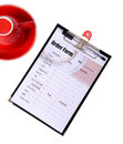 Drinking order form attach on clipboard on white background Stock Photos