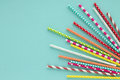Drinking paper colorful straws for summer cocktails on light blue background. Royalty Free Stock Photo