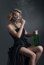 Drinking and smoking woman with skull make-up Stock Photography