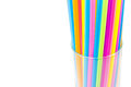 Drinking straws in glass isolated on white background Royalty Free Stock Photo