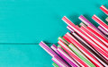 Drinking straws for party on blue pastel background with copy space Royalty Free Stock Photo