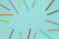 Drinking straws for party on blue pastel background with copy space. Royalty Free Stock Photo