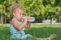 Drinking water little girl Royalty Free Stock Photography