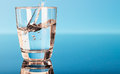 Drinking water is poured into a glass Royalty Free Stock Photos