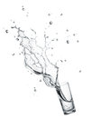 Drinking water splashing glass of isolated on white Royalty Free Stock Photos