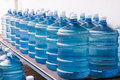 Drinking water supply rows of big bottle of Stock Image