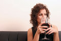 Drinking wine portrait of a beautiful latin woman red Royalty Free Stock Image