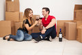 Drinking wine in their new house attractive young hispanic couple and celebrating they just bought a home Royalty Free Stock Photos