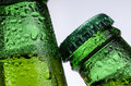 Drinks beer macro photography of two bottles of on white background Royalty Free Stock Photography
