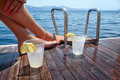 Drinks on the deck of a sailing yacht enjoying in greece Royalty Free Stock Photos