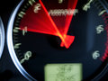 Drive car dials in motion with red toned blur Royalty Free Stock Images