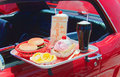 Drive in close up of a 's food tray with burger fries and a soda Royalty Free Stock Photography