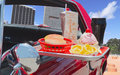 Drive in close up of a 's food tray with burger fries and a soda Stock Photo