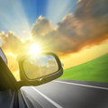 Drive to the sunshine car and rear view mirror on road concept for business speed or success Stock Images