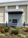 Drive-up ATM Machine Beside A Bank Royalty Free Stock Photo