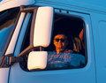 Driver in the cabin him truck of Royalty Free Stock Photos