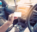 Driver in car hold a blank business card Royalty Free Stock Photo