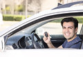 Driver in car showing keys hispanic smiling new and Royalty Free Stock Photos