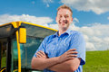 Driver in front of his bus Royalty Free Stock Photography