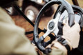 Driver holds the steering wheel with gloves atv Stock Image