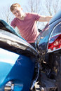 Driver inspecting damage after traffic accident teenage Royalty Free Stock Photo