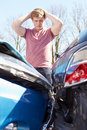 Driver inspecting damage after traffic accident teenage Royalty Free Stock Photos