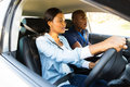 Driver making mistake beautiful african student during driving test Royalty Free Stock Photo