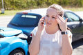 Driver making phone call after traffic accident Stock Images
