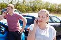 Driver making phone call after traffic accident female Royalty Free Stock Photography