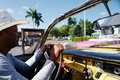 Driver of Old car in Havana, Cuba Royalty Free Stock Photo