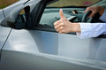 Driver's hand showing thumbs up gesture Royalty Free Stock Images