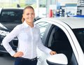 Driver woman standing near new car Royalty Free Stock Photography