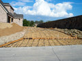 Driveway construction new prepared for concrete with rebar new home in the background Stock Photos