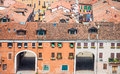 Driveway portals in venice buildings doors large under tile roofs Stock Photo